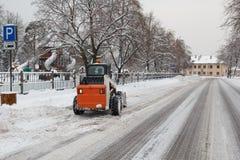 Lince pequeno da máquina escavadora que trabalha na rua Fotografia de Stock Royalty Free