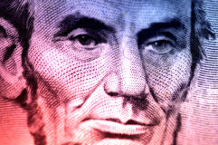 Lincoln. Macro Photo of Abraham Lincoln On The Five Dollar Bill With Color and Blur Effect