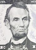 Lincoln Abraham stående på dollarräkning Arkivbild
