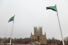 Lincoln Cathedral flanked by Flag Of Lincolnshire, viewed from c Stock Photography
