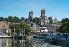 Lincoln cathedral reflecting in Brayford waterfront Stock Photos