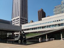 Lincoln Center in New York City. Reflecting pool and stone sculpture, a study of lines, angles, and planes Stock Photos