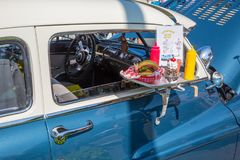 1950 Lincoln with Drive-In Tray. MATTHEWS, NC - September 4, 2017: Closeup of a 1950 Lincoln with drive-in food tray on display at the Matthews Auto Reunion & stock images