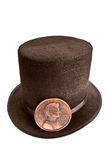 Lincoln hat and penny. A commemorative Abraham Lincoln hat and penny isolated on white stock photos