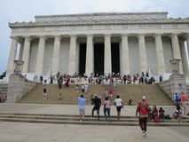 Lincoln Memorial Being Visited by Tourists. Tourists visit the Lincoln Memorial in the summer and see an American monument royalty free stock photography