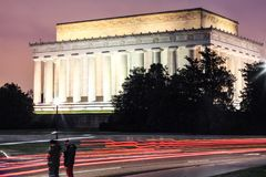 Lincoln memorial at night with couple stand still. Amazing long exposure at Lincoln memorial at night with car tails stock images