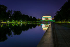 The Lincoln Memorial reflecting in the Reflection Pool at night Stock Image