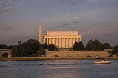 Lincoln Memorial and Washington Monument in the Setting Sun. Lit by the early evening setting sun, the Lincoln Memorial and the Washington Monument stand as Stock Photography