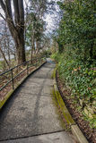 Lincoln Park Sidewalk. A view of a sidewalk leading the water at Lincoln Park in West Seattle, Washington Stock Images