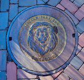 Lincoln Park Zoo Manhole Cover. This is a Winter picture of an iconic Lincoln Park Zoo Manhole Cover in the Lincoln Park Zoo located in Chicago, Illinois in Cook royalty free stock images