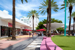 Lincoln Road, a famous tourist destination in Miami Beach. MIAMI BEACH, USA - AUGUST 27, 2016 : People, shops and restaurants at Lincoln Road, a famous tourist Stock Photos