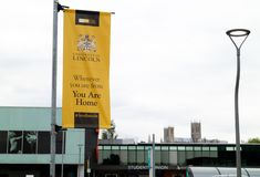 Lincoln, United Kingdom - 07/21/2018: A banner for the Universi. Ty of Lincoln with the #lovelincoln. With the cathedral in the background royalty free stock photo