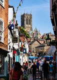 Lincoln, United Kingdom - 07/21/2018: The base of Steep Hill in. Lincoln, with Lincoln Cathedral in view stock photos