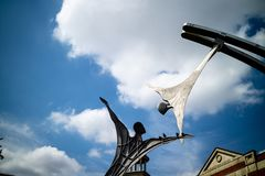 Lincoln, United Kingdom - 07/21/2018: The Empowerment sculpture. That reaches across the river Witham in Lincoln. Designed by Stephen Broadbent stock image