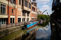 Lincoln, United Kingdom - 07/21/2018: The River Witham going through the centre of Lincoln, with the empowerment sculpture in. Background stock photos