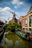 Lincoln, United Kingdom - 07/21/2018: The River Witham going through the centre of Lincoln, with the empowerment sculpture in. Background stock image