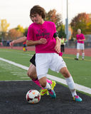 Lincolnway Central High School Soccer Forward. Dribbles around a defender Stock Photography