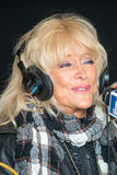 Linda Vaughn at Indianapolis 2014. Linda Vaughn, the first lady of auto racing in USA seen here during a promotional interview at the Indianapolis 500 in May Royalty Free Stock Photography