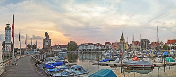 Lindau harbor. Panorama view Lindau harbor with its famous lighthouse and lion Royalty Free Stock Images