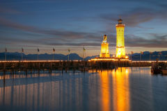 Lindau harbour on Lake Bodensee, Germany. Twilight scene of Lake Bodensee (Constance) with a statue of the Bavarian Lyon and a lighthouse guarding the entrance Stock Photo