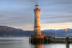 Lindau lighthouse, Bavaria, Germany. Golden hour on Bavaria's only lighthouse guarding the entrance to Lindau harbor, Germany. Autumn time. HDR image Stock Images