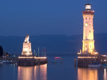 Lindau Lighthouse Landscape. Lighthouse and Harbour entrance in Lindau, Germany. The hills in the background belong to Austria Stock Image