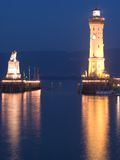 Lindau Lighthouse Portrait. Lighthouse and Harbour entrance in Lindau, Germany. The hills in the background belong to Austria Stock Photos