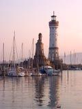 Lindau Lighthouse sunset. Entrance to Lindau harbour, Germany Royalty Free Stock Photo