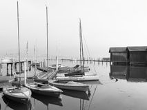 A graphical view of boats in Lindau`s harbor, Lindau, Bavaria, Germany stock images