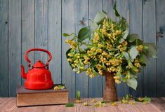 Linden flower in a vase and teapot, book Royalty Free Stock Images