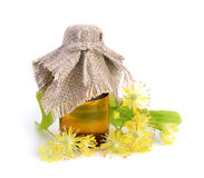 Linden flowers with pharmaceutical bottle Royalty Free Stock Image