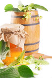 Linden honey jar and barrel with flowers Stock Photo