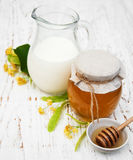 Linden honey and milk. On a old wooden background Royalty Free Stock Photography