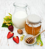 Linden honey and milk Royalty Free Stock Photo