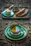 Linden tea for breakfast. Breakfast with a cup of linden tea, butter and homemade bread stock image