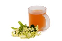 Linden tea cup. Cup of linden tea and linden blossom royalty free stock photos