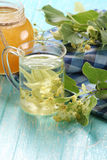 Linden tea in cup of glass Stock Images