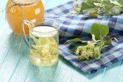 Linden tea in cup of glass Royalty Free Stock Images