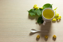 Linden tea cup with linden flowers on textured background Stock Photo