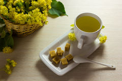 Linden tea cup and woven basket with linden flowers - Tea time Stock Image