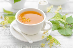 Linden tea. With flowers and leaves Stock Photo