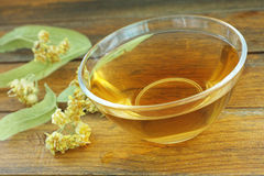 Linden tea in a glass cup Royalty Free Stock Image