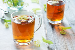 Linden tea. In glass mug Stock Photo