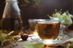 Linden tea with honey on wooden background Royalty Free Stock Images