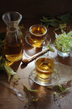 Linden tea with honey on wooden background in sunshine Stock Images