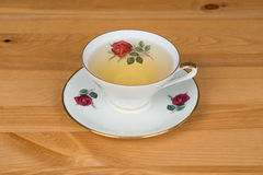 Linden tea in a mug. On a wooden surface Stock Images