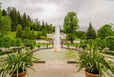 Linderhof Palace and fountain group Flora and puttos. Bavaria, Germany. ETTAL, GERMANY - JUNE 5, 2016: Linderhof Palace and fountain group Flora and puttos in Royalty Free Stock Photography