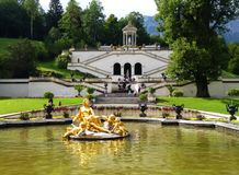 Linderhof Palace, golden fountain with goddess Flora and Puttos, Bavaria, Germany royalty free stock photos