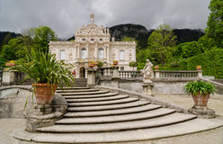 Linderhof Palace is a Schloss in Germany, in southwest Bavaria near Ettal Abbey. ETTAL, GERMANY - JUNE 5, 2016: Linderhof Palace is a Schloss in Germany, in Stock Images