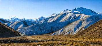Lindis Pass. The Lindis Pass in early spring. The Lindis Pass connects the MacKenzie Basin to Central Otago in the South Island of New Zealand Stock Photo